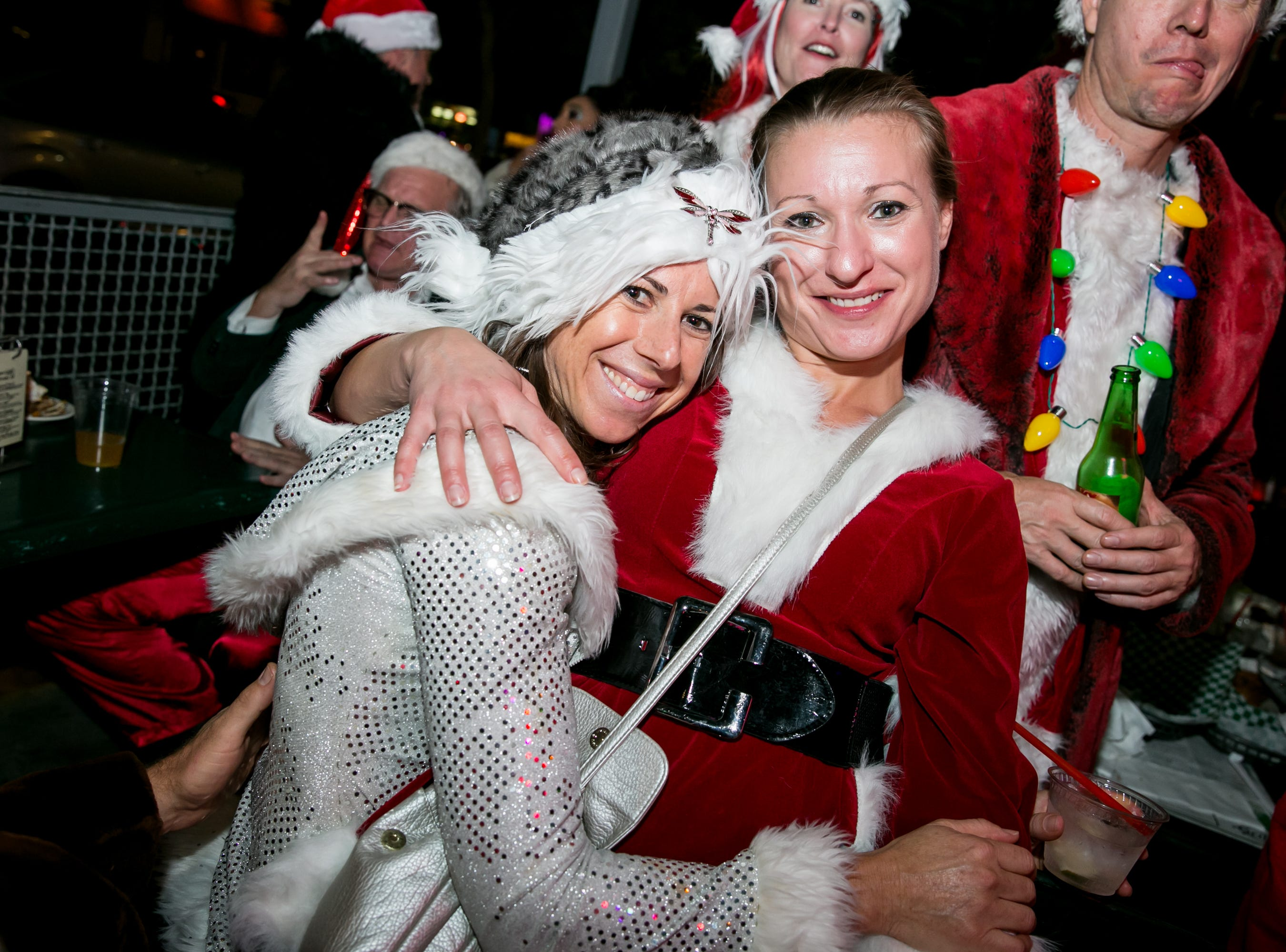 These ladies received some hilarious photo bombs during Santarchy on Saturday, December 8, 2018.