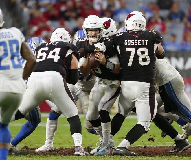 Arizona Cardinals quarterback Josh Rosen (3) is sacked by Detroit Lions defensive tackle A'Shawn Robinson (91) while center Mason Cole (64) and offensive guard Colby Gossett (78) block during the second half in Glendale, Ariz. December 9.
