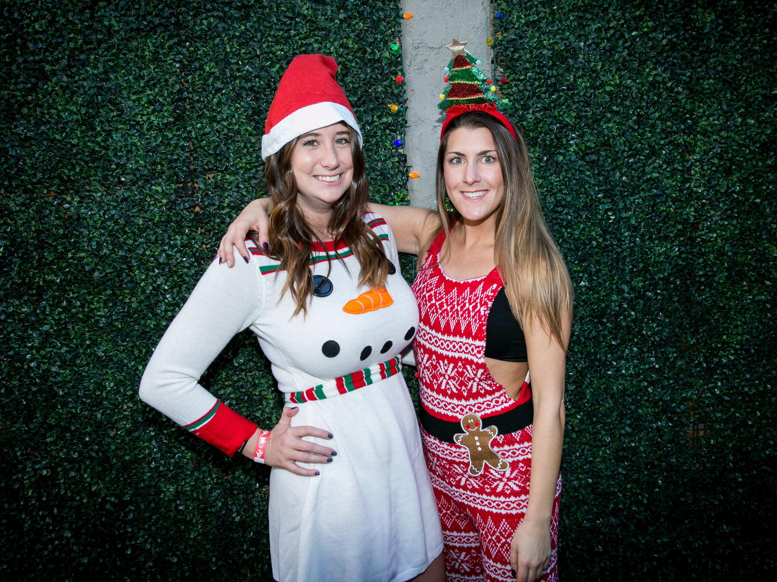 Her Frosty the Snowman dress was adorable during the Scottsdale Santa Crawl at Wasted Grain on Saturday, December 8, 2018.