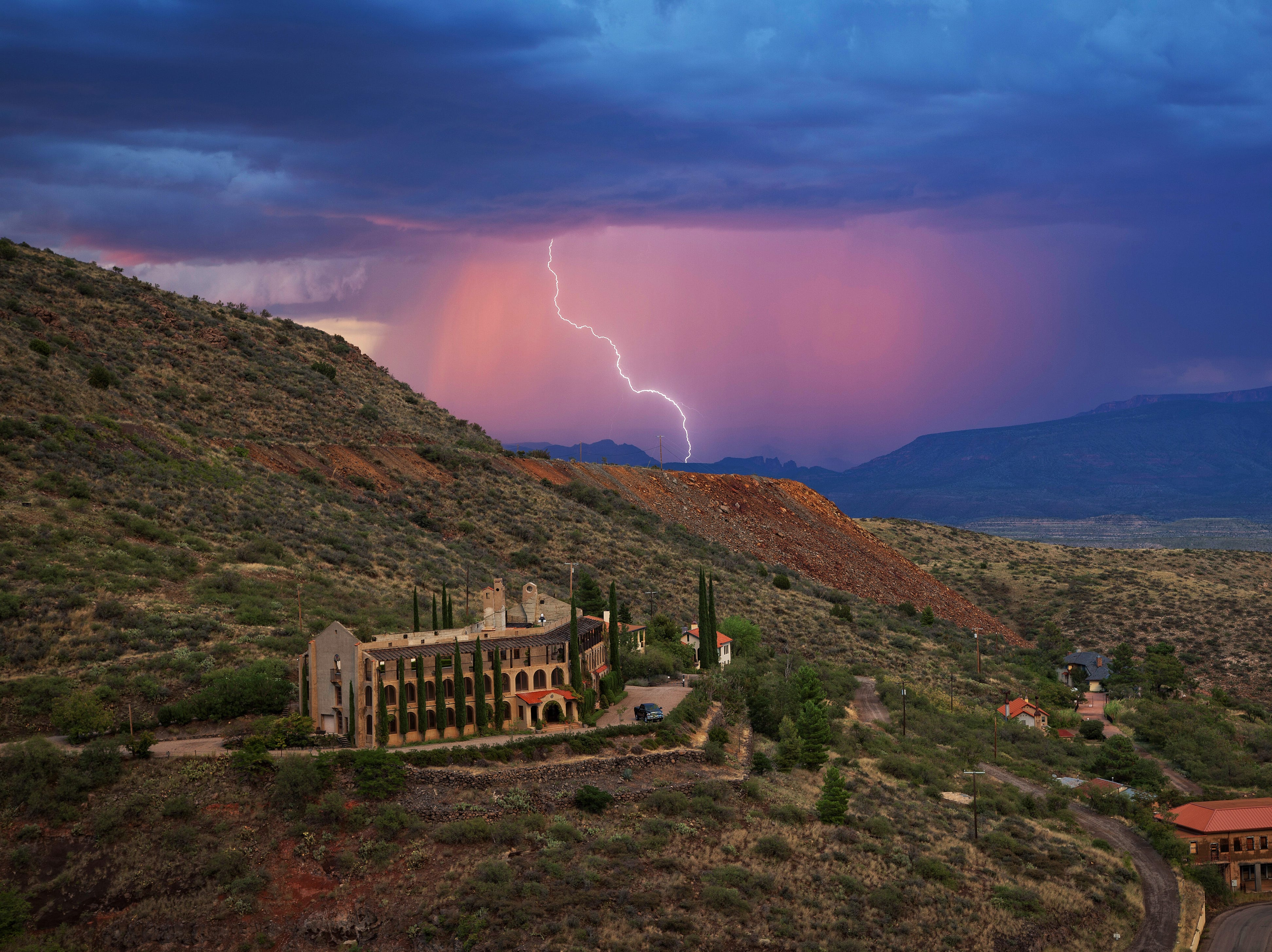 Spectacular storms are seen near the 100-year-old former Little Daisy Hotel in Jerome, which was later turned into a single-family home and is now on the market.