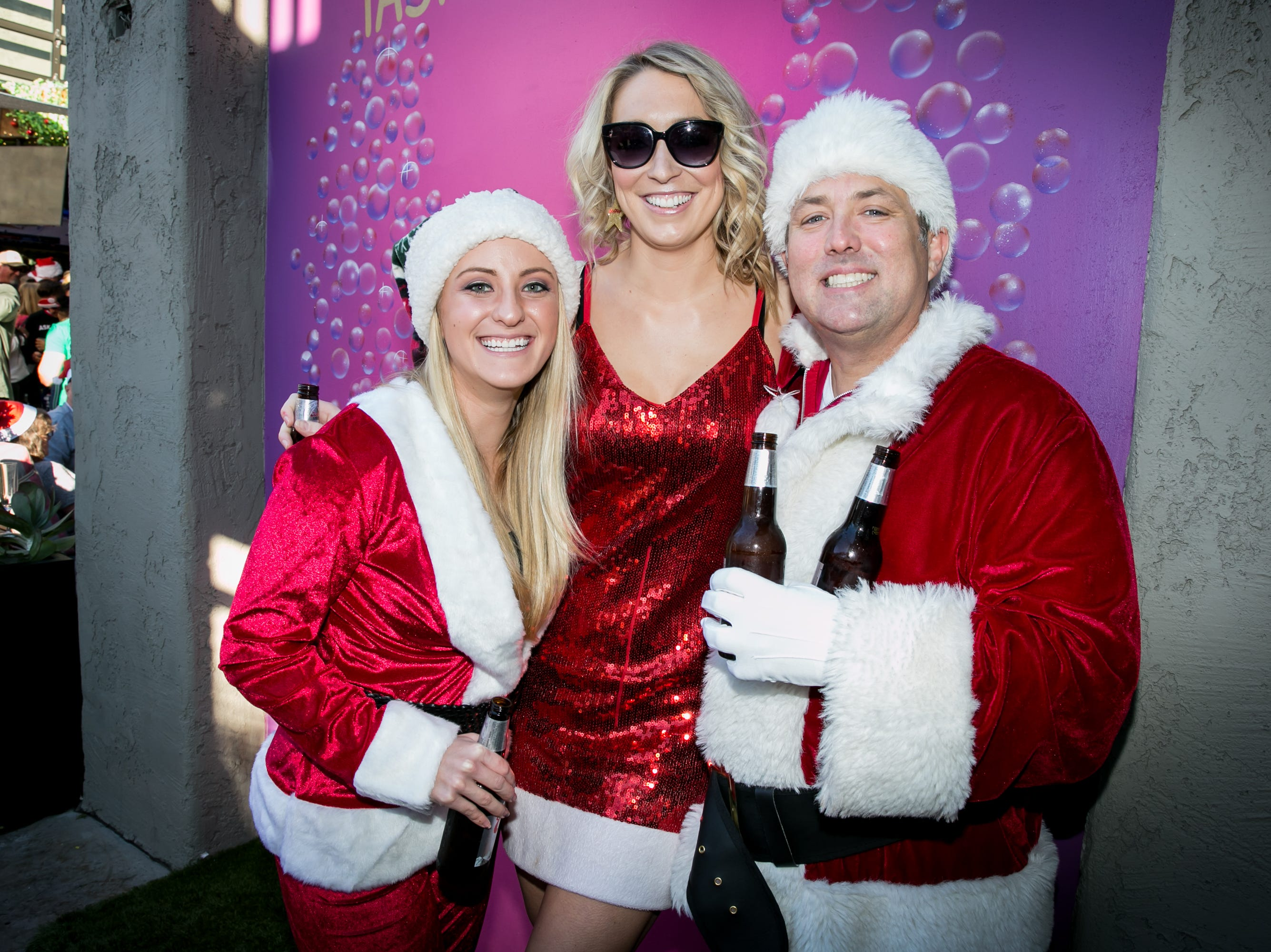 This trio had a blast during the Scottsdale Santa Crawl at Wasted Grain on Saturday, December 8, 2018.