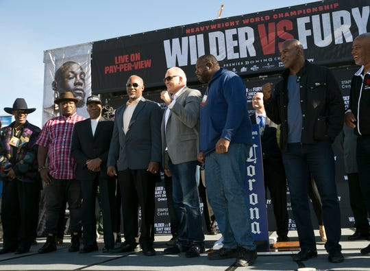 Former heavyweight champions (left to right) Michael Spinks, Buster Douglas, Earnie Shavers, Lennox Lewis, Gerry Cooney, Riddick Bowe, and Evander Holyfield attend the Deontay Wilder-Tyson Fury weigh-in ceremony on Nov. 30.