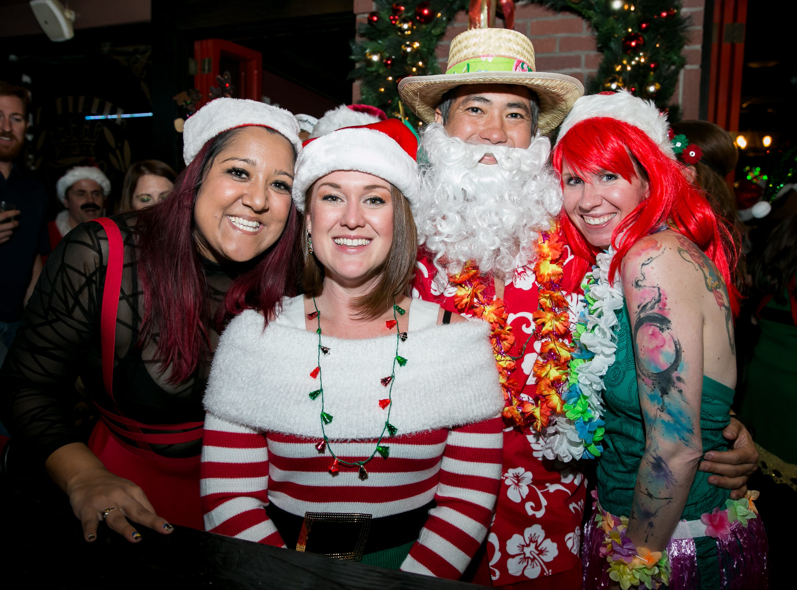 This group felt some tropical vibes at The Kettle Black during Santarchy on Saturday, December 8, 2018.