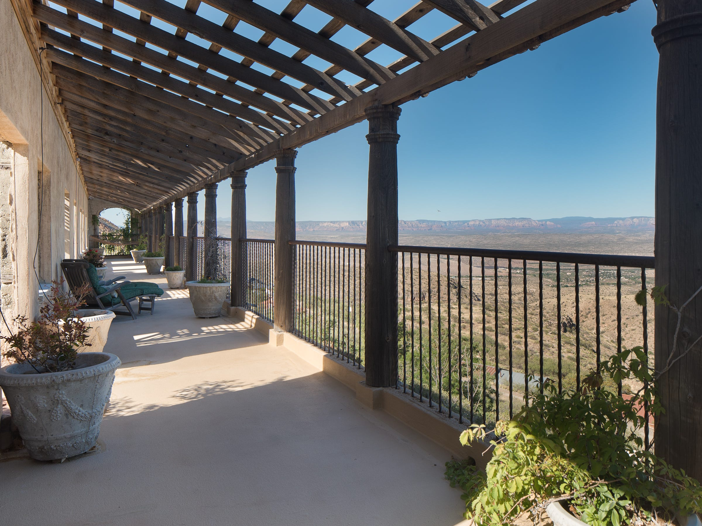 Verde Valley views surround the 100-year-old former Little Daisy Hotel in Jerome, which was later turned into a single-family home and is now on the market.