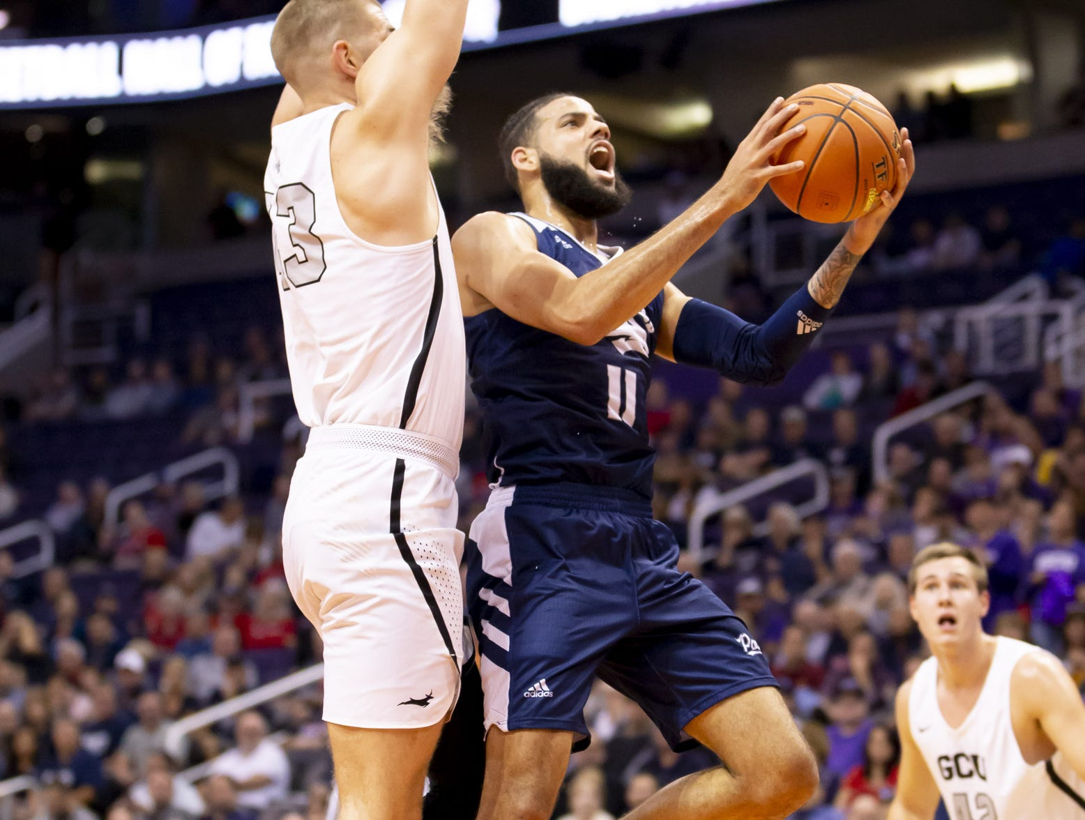 Forward Cody Martin (11) of Nevada Wolf Pack drives to the basket against the Grand Canyon Antelopes during the 2018 Jerry Colangelo Classic at Talking Stick Resort Arena on Sunday, December 9, 2018 in Phoenix, Arizona.