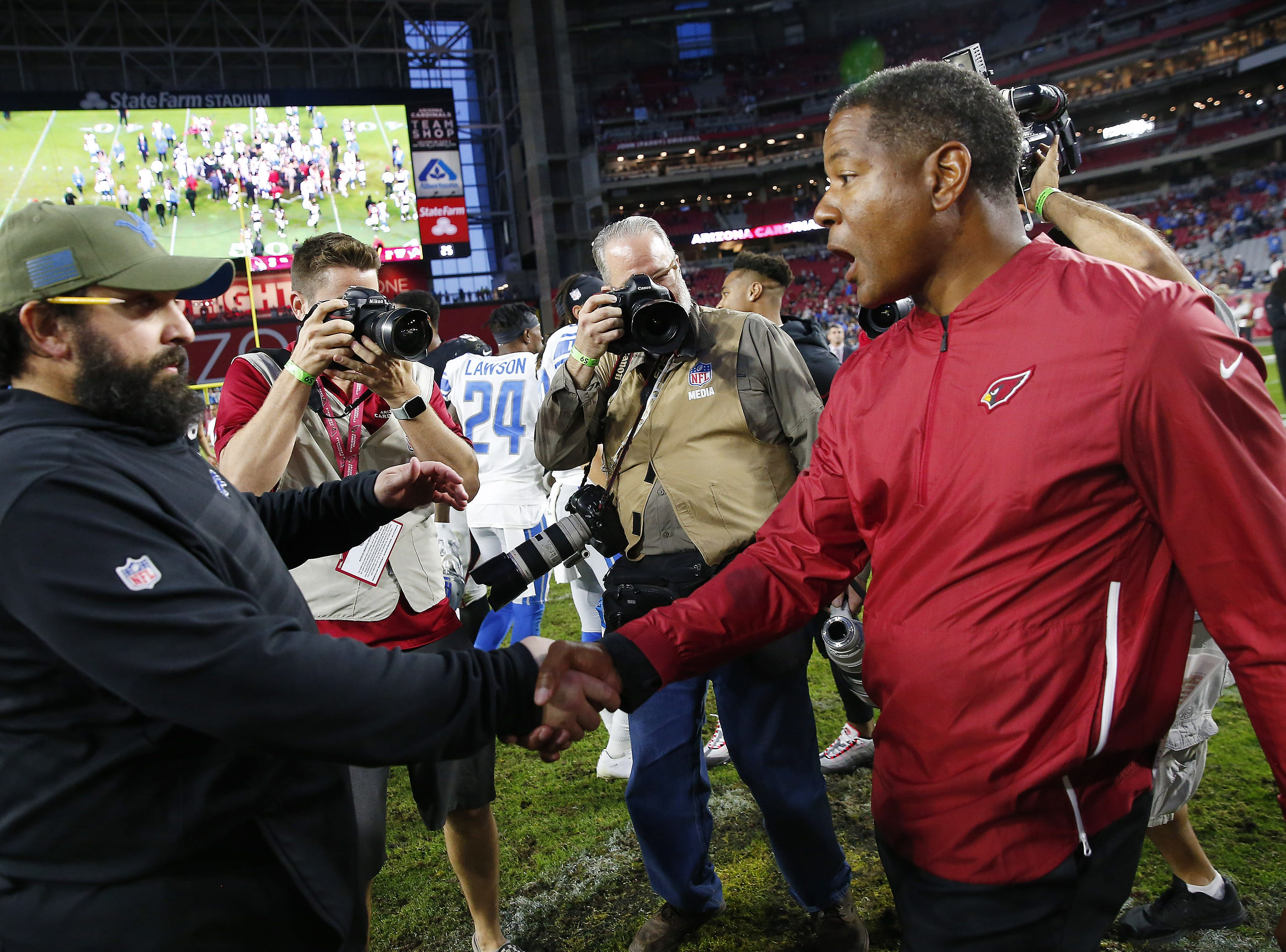 Detroit Lions head coach Matt Patricia shakes hands with Arizona Cardinals head coach Steve Wilks after the Lions won 17-3 in Glendale, Ariz. December 9.