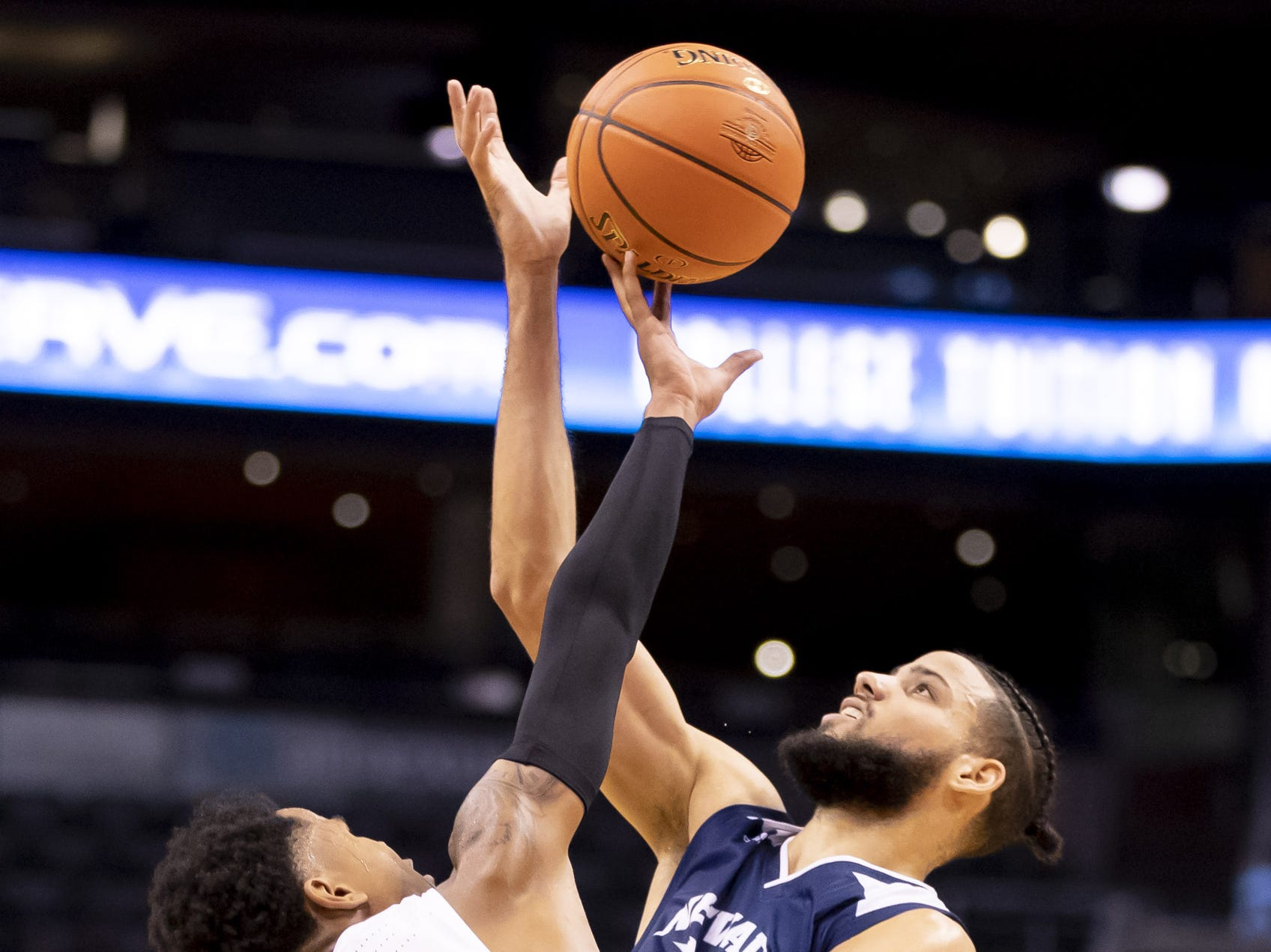 Guard Damari Milstead (11) of the Grand Canyon Antelopes and forward Caleb Martin (10) of Nevada Wolf Pack reach for a pass during the 2018 Jerry Colangelo Classic at Talking Stick Resort Arena on Sunday, December 9, 2018 in Phoenix, Arizona.