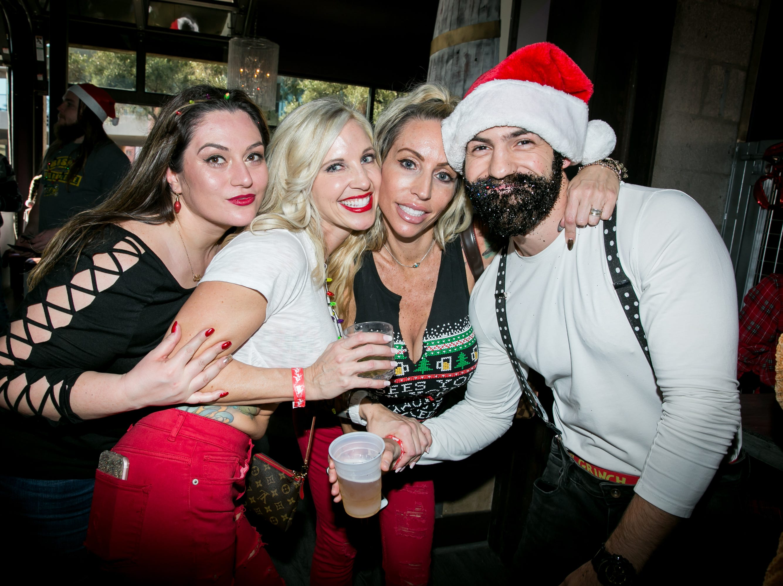 His glitter beard was fantastic during the Scottsdale Santa Crawl at Wasted Grain on Saturday, December 8, 2018.