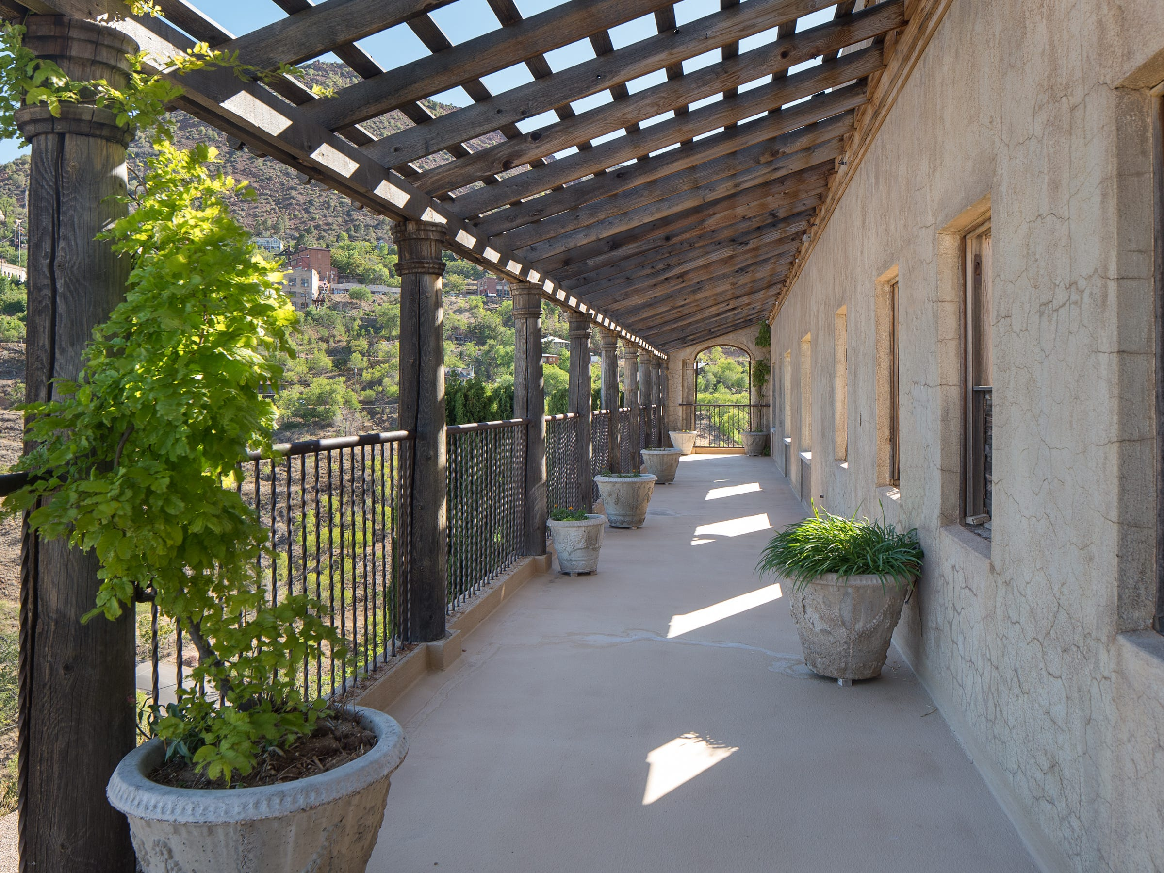 The colonnade that faces toward the town of Jerome is seen at the 100-year-old former Little Daisy Hotel in Jerome, which was later turned into a single-family home and is now on the market.