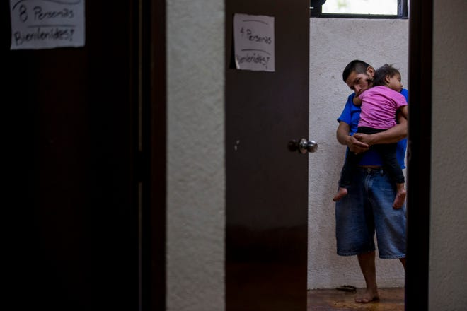 Lorenzo Chial, 26, of Guatemala, holds his daughter, Maria Esperanza, 2, on  June 21, 2018, at Casa Belen, a migrant shelter in Nogales, Sonora, Mexico.