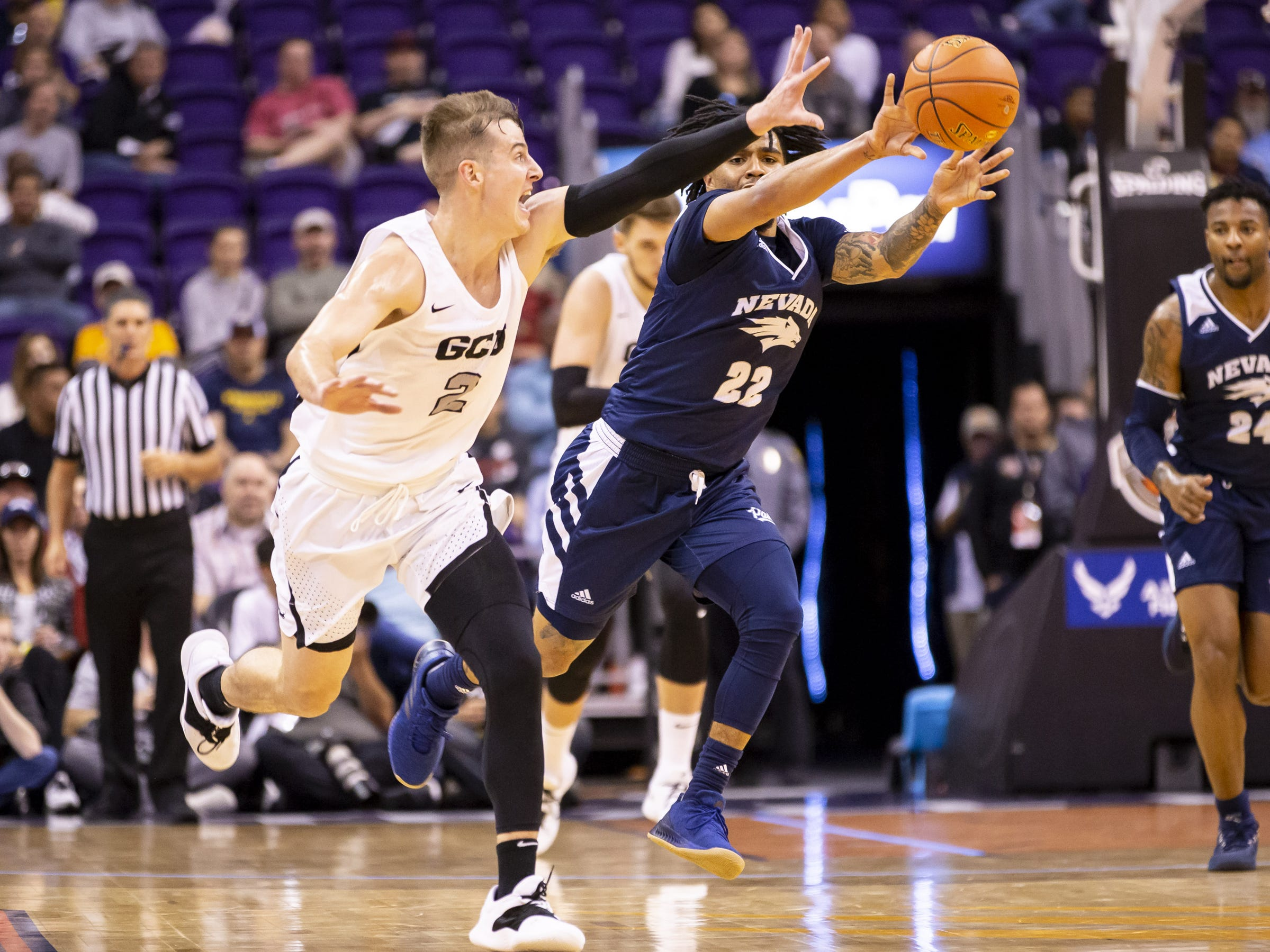 Guard Jazz Johnson (22) of Nevada Wolf Pack passes against guard Trey Drechsel (2) of the Grand Canyon Antelopes during the 2018 Jerry Colangelo Classic at Talking Stick Resort Arena on Sunday, December 9, 2018 in Phoenix, Arizona.