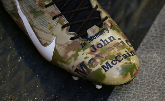 Arizona Cardinals wide receiver Larry Fitzgerald wears spikes honoring the late Sen. John McCain during a game on Dec. 9 at State Farm Stadium.