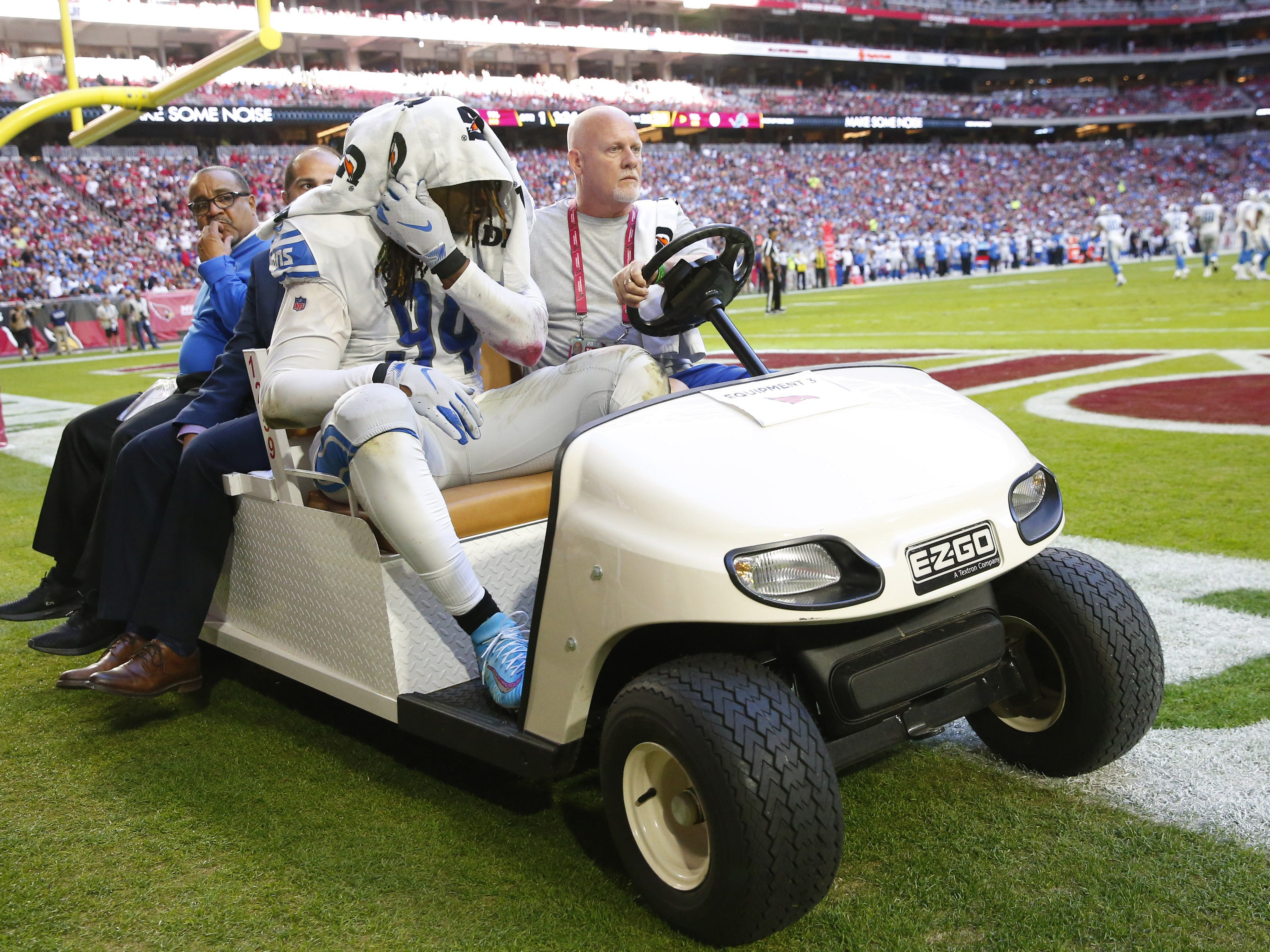 Detroit Lions defensive end Ezekiel Ansah (94) is carted off the field after an injury against the Arizona Cardinals during the second half in Glendale, Ariz. December 9.