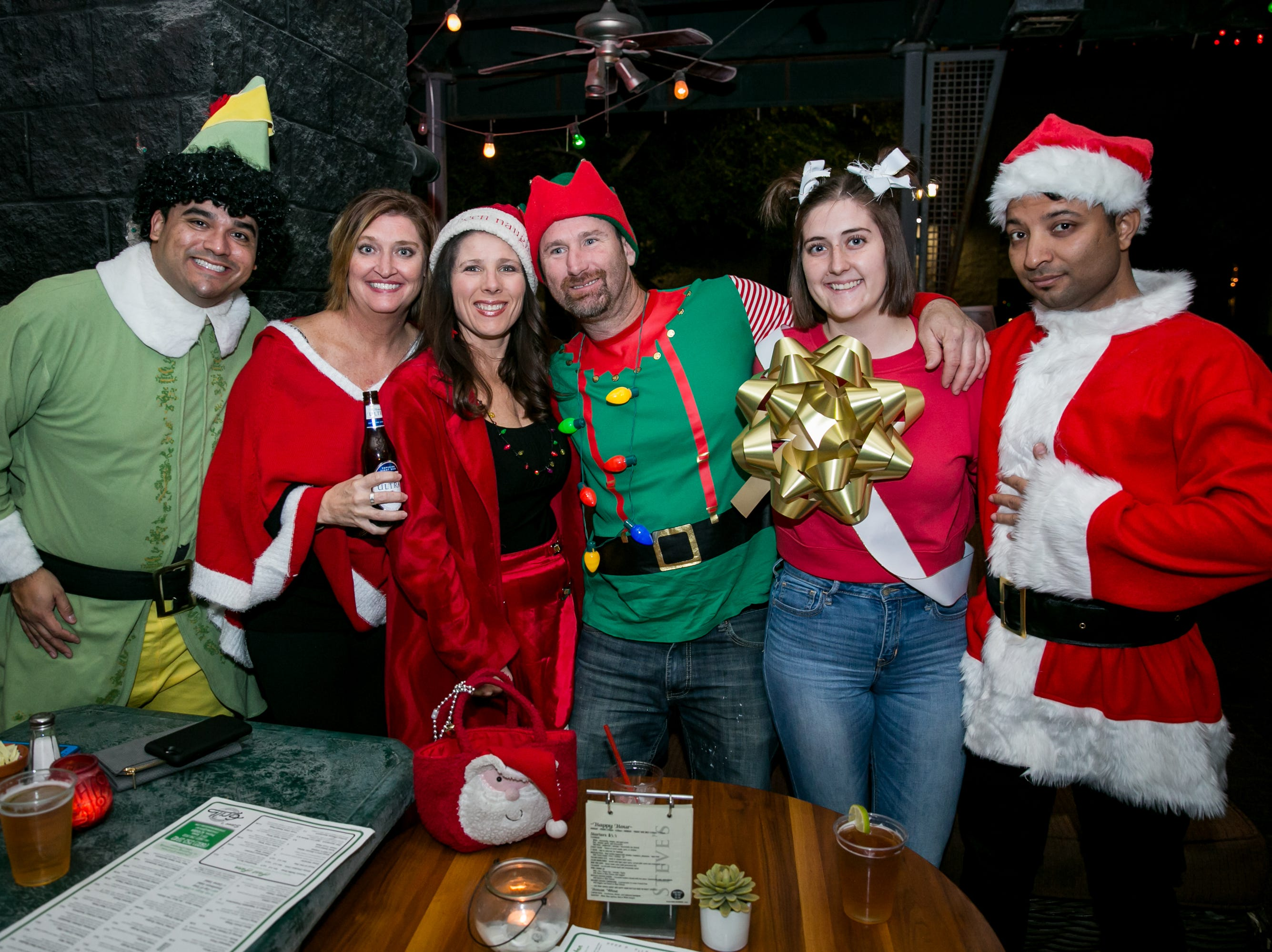 This group got festive at Steve's Greenhouse Grill during Santarchy on Saturday, December 8, 2018.