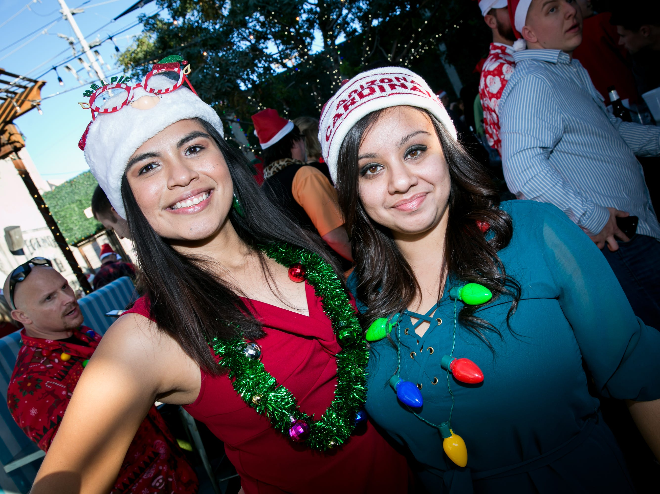 These ladies showed their love for the Cardinals during the Scottsdale Santa Crawl at Wasted Grain on Saturday, December 8, 2018.