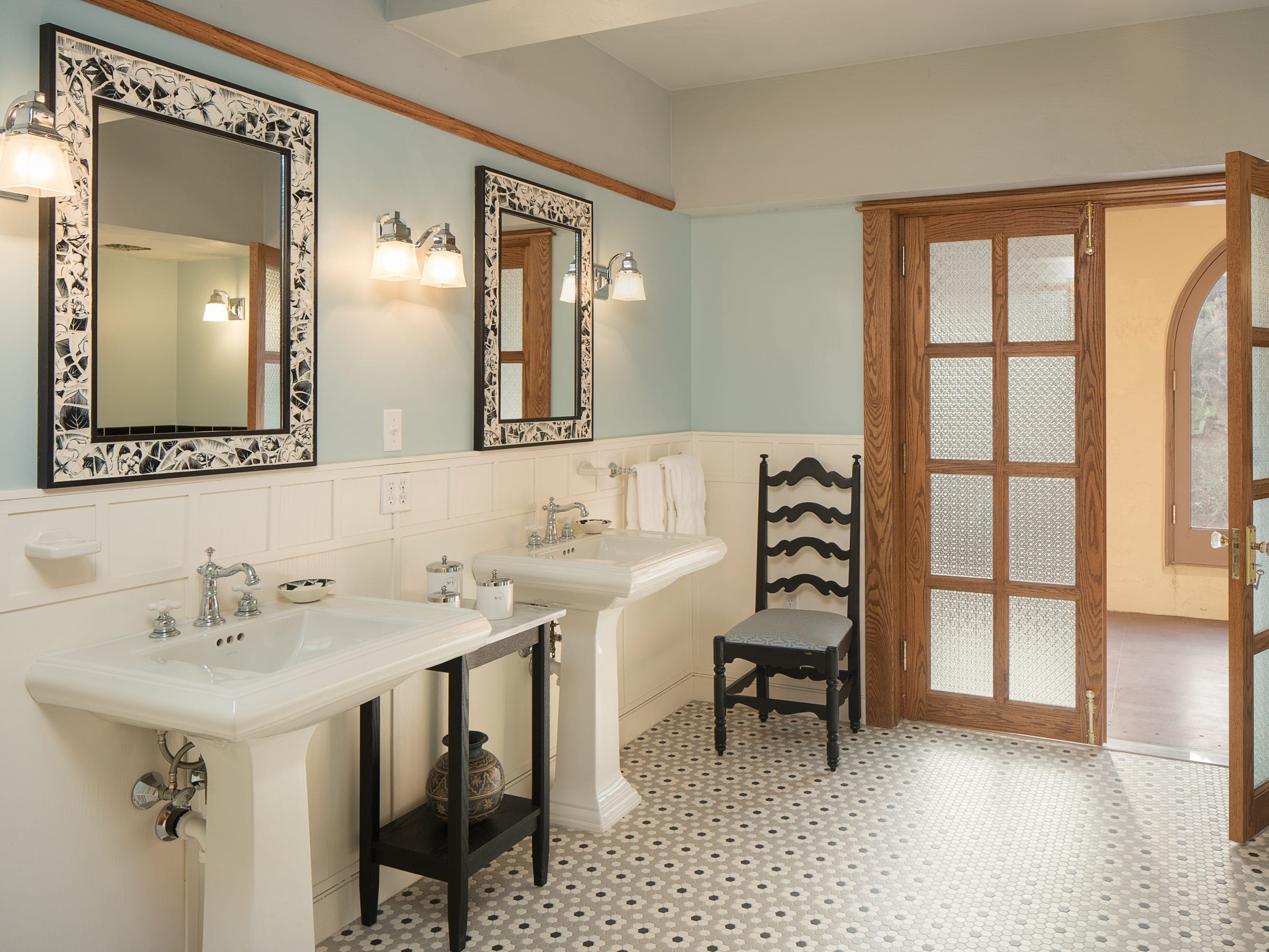 The bathroom for king bedroom No. 2 is seen at the 100-year-old former Little Daisy Hotel in Jerome, which was later turned into a single-family home and is now on the market.