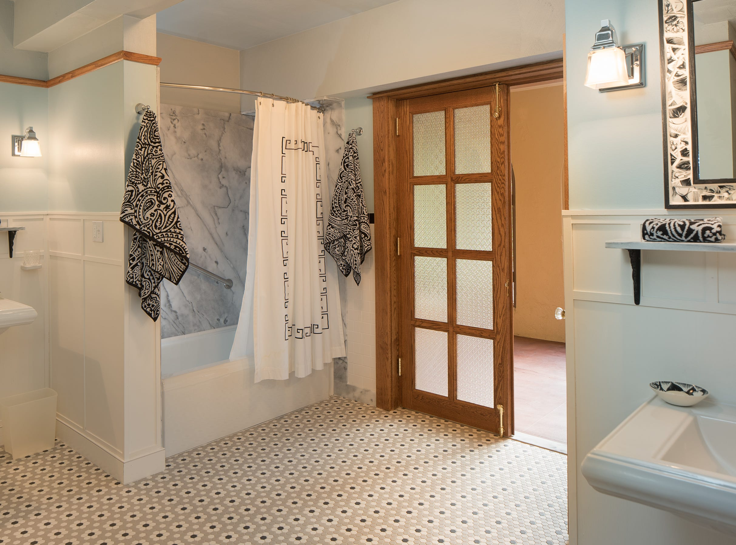 The bathroom for the king bedroom No. 2 is seen at the 100-year-old former Little Daisy Hotel in Jerome, which was later turned into a single-family home and is now on the market.