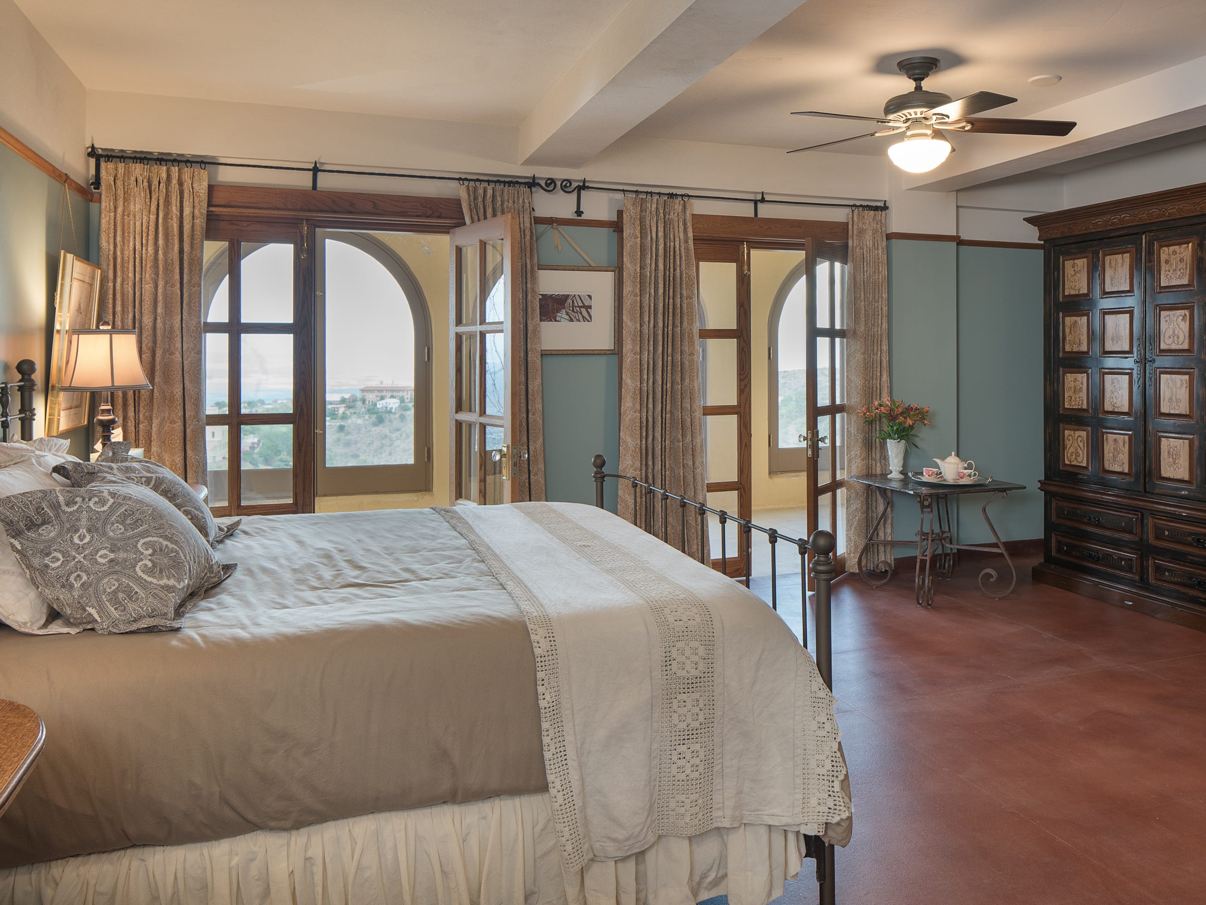 The king bedroom No. 2 is seen at the 100-year-old former Little Daisy Hotel in Jerome, which was later turned into a single-family home and is now on the market.