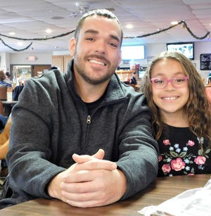 Fremont resident Jamin Lozano and his 9-year-old daughter, Janessa, take a moment to share their thoughts after Lozano was honored Saturday at the Clyde VFW for his military service.