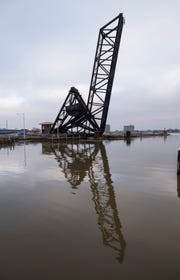 The Pere Marquette railroad bridge rises above the Black and St. Clair rivers Monday, Dec. 10, 2018 in Port Huron. On Wednesday, the Port Huron Yacht Club, the Army Corp of Engineers and a group of people trying to save the bridge will have a meeting to help determine its fate.