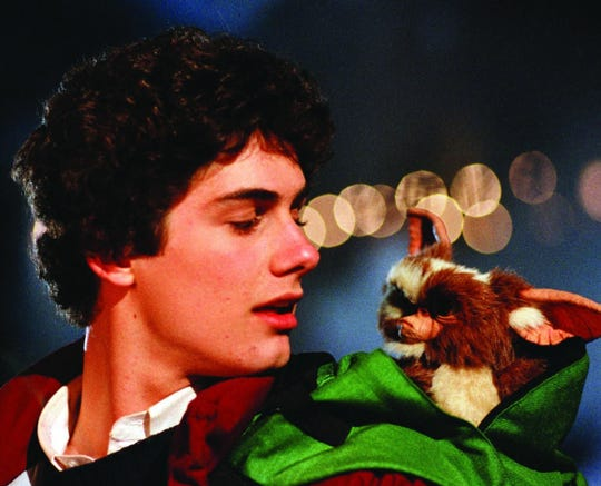 "Zach Galligan stars with Gizmo in a scene from 1984's ""Gremlins."""
