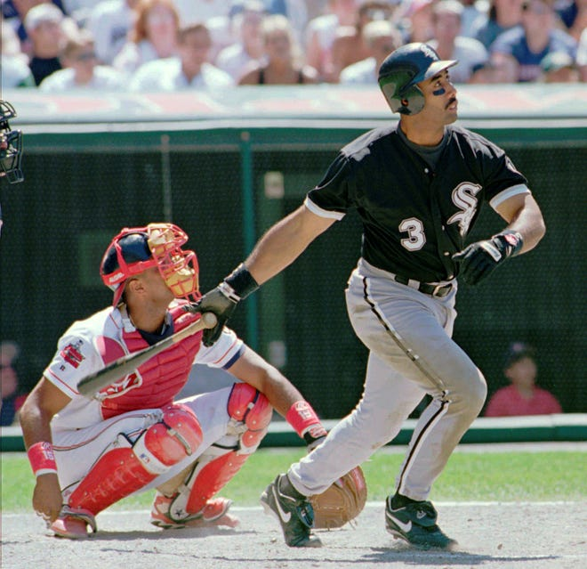 FILE - In this Saturday, July 6, 1996, file photo, Chicago White Sox's Harold Baines (3) watches his ninth inning solo home run head for the center field seats during the White Sox's 3-2 win over the Cleveland Indians in Cleveland. Smooth-swinging Baines was elected to the baseball Hall of Fame on Sunday, Dec. 9, 2018. (AP Photo/Jeff Glidden, File)