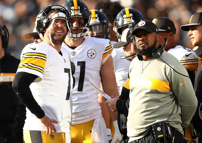 Pittsburgh Steelers quarterback Ben Roethlisberger, left, talks with head coach Mike Tomlin during Sunday's game vs. the Oakland Raiders. The Steelers lost the game, 24-21, to fall to 7-5-1 on the season.  (AP Photo/Ben Margot)