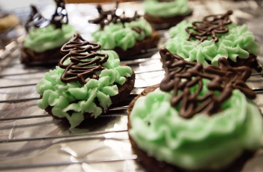 Mint chocolate chip cookies with Christmas tree decorations.