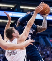 Nevada's Jordan Caroline, top, drives to the basket against Grand Canyon's Gerald Martin during the second half Sunday in Phoenix.