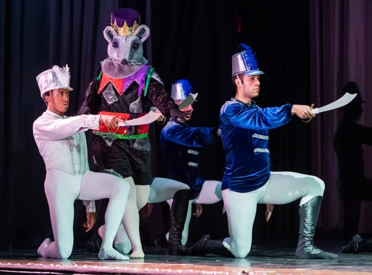 The Mouse Queen, played by Jerilee Kent, watches as the Nutcracker Prince, Tre Taylor, left, and other members of the Reno Dance Company prepare for battle.