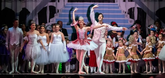 Cast members respond to audience applause at the ballet's conclusion.