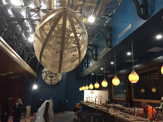 Work proceeds in the main room of the new Zeppelin restaurant, including work on these decorative zeppelins, the famed early 20th century airships from which the restaurant takes its name.