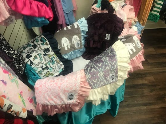 Blankets designed by Cuddle Couture owner Kelly McMillan. They can be bought online, or at Fancy Pants, 3566, Knickerbocker Rd.