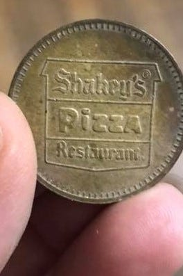 A Shakey's token was found inside the walls of a home in Santa Rita during a remodel in early 2018.