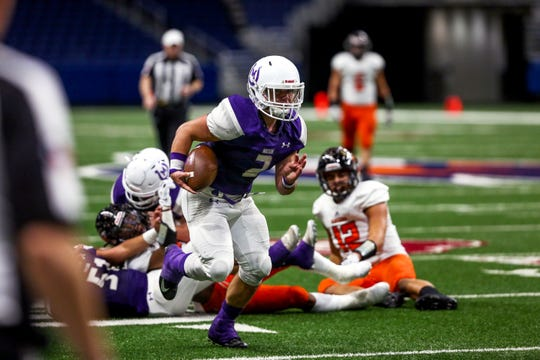 Mason's Jake Cockerham (2) breaks several tackles on the way to a big touchdown reception Friday, Dec. 7, in a Class 2A, Division I quarterfinal game against Refugio at the Alamodome in San Antonio.
