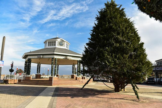 Rehoboth Beach Bandstand sits decorated with a tree and garlands for the holidays on Monday, Dec 10, 2018. The city previously ordered the St Edmond Catholic Church to take a Nativity scene down from this area.