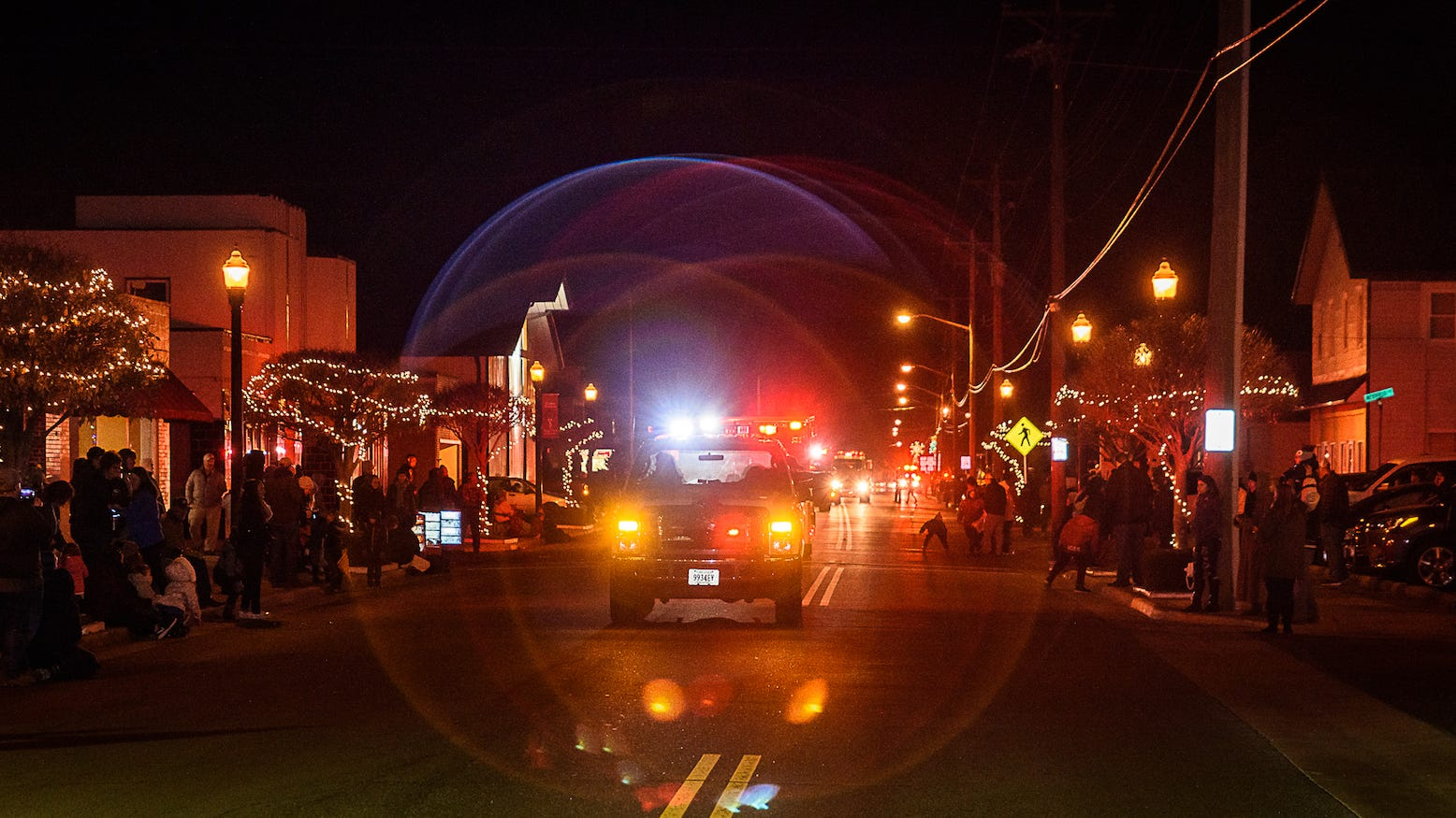 The Exmore Fire Department leads off   off the town's annual Christmas parade on Main Street on Saturday, Dec. 8.