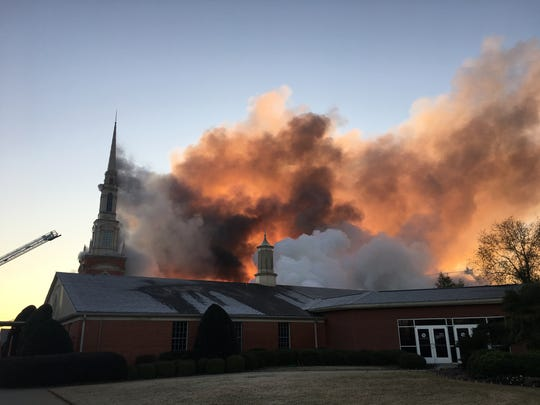 Smoke and flames are seen rising from First Baptist Bossier on the morning of Dec. 10.