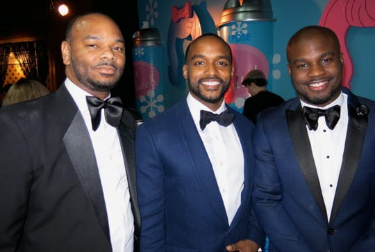 Shreveport Mayor-elect Adrian Perkins (center) with close friend Quinn Eubanks (left) and Campaign Manager Joshua Williams on Saturday Dec. 8 at Christmas in the Sky. The photo was taken just after Perkins had guided friend Alaetra Combs aside and out of the photo.