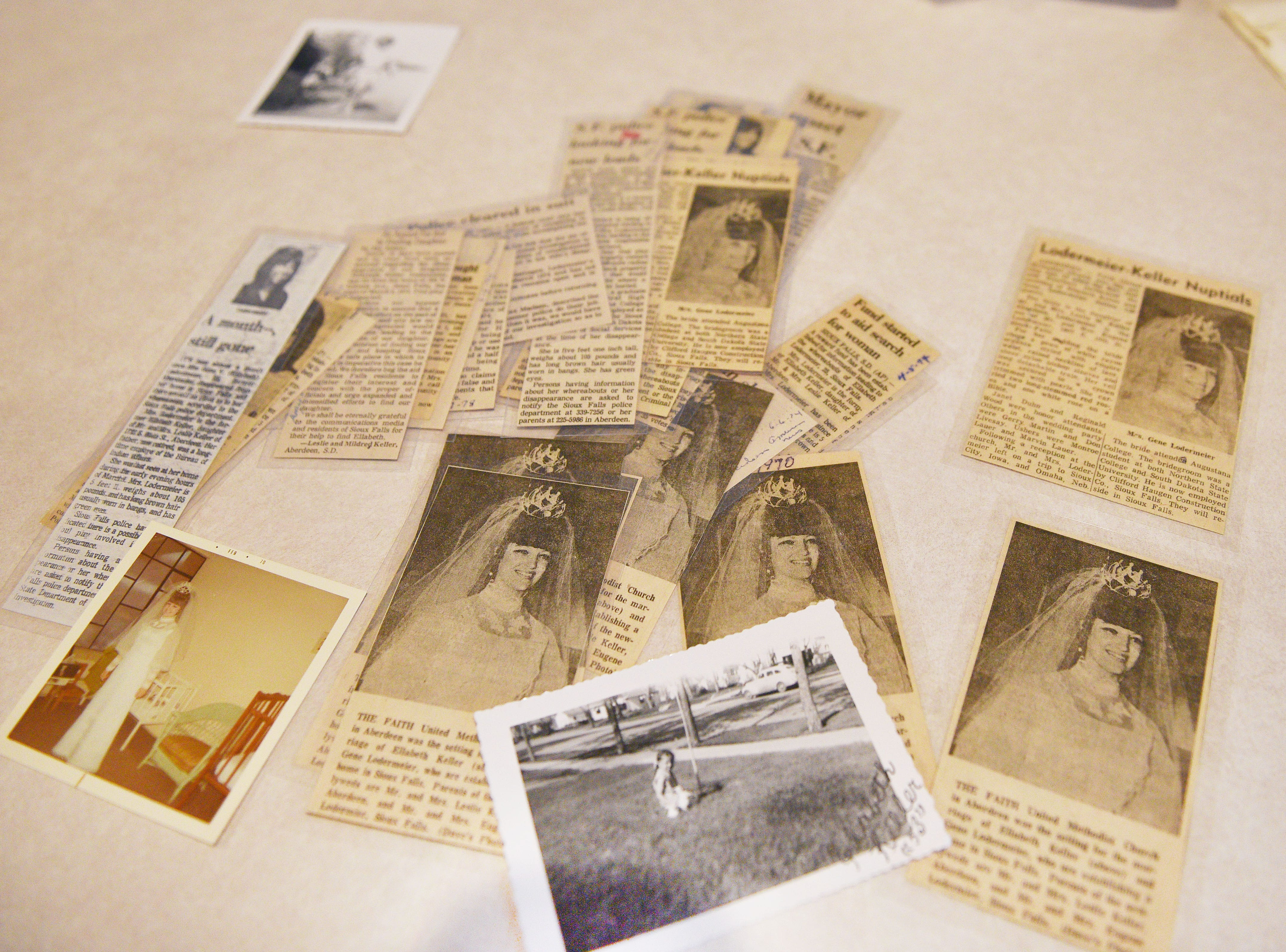 Elizabeth Crow, Ellabeth Lodermeier's niece, shows old newspaper clippings her grandpa saved about her aunt Friday, Dec. 6, at her home in Sioux Falls. Crow was 7 years old when Ellabeth disappeared in 1974. Elizabeth's mom, Sandra Herman, never stopped trying to get answers to her sister's disappearance.