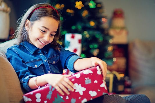 Happy Girl Is Opening Her Christmas Gift