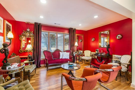The red room is where Jeff and Kyaw decided to place furniture that doesn't necessarily go with the rest of the house. It's also a salon of sorts, where they retire to discuss issues of the day.