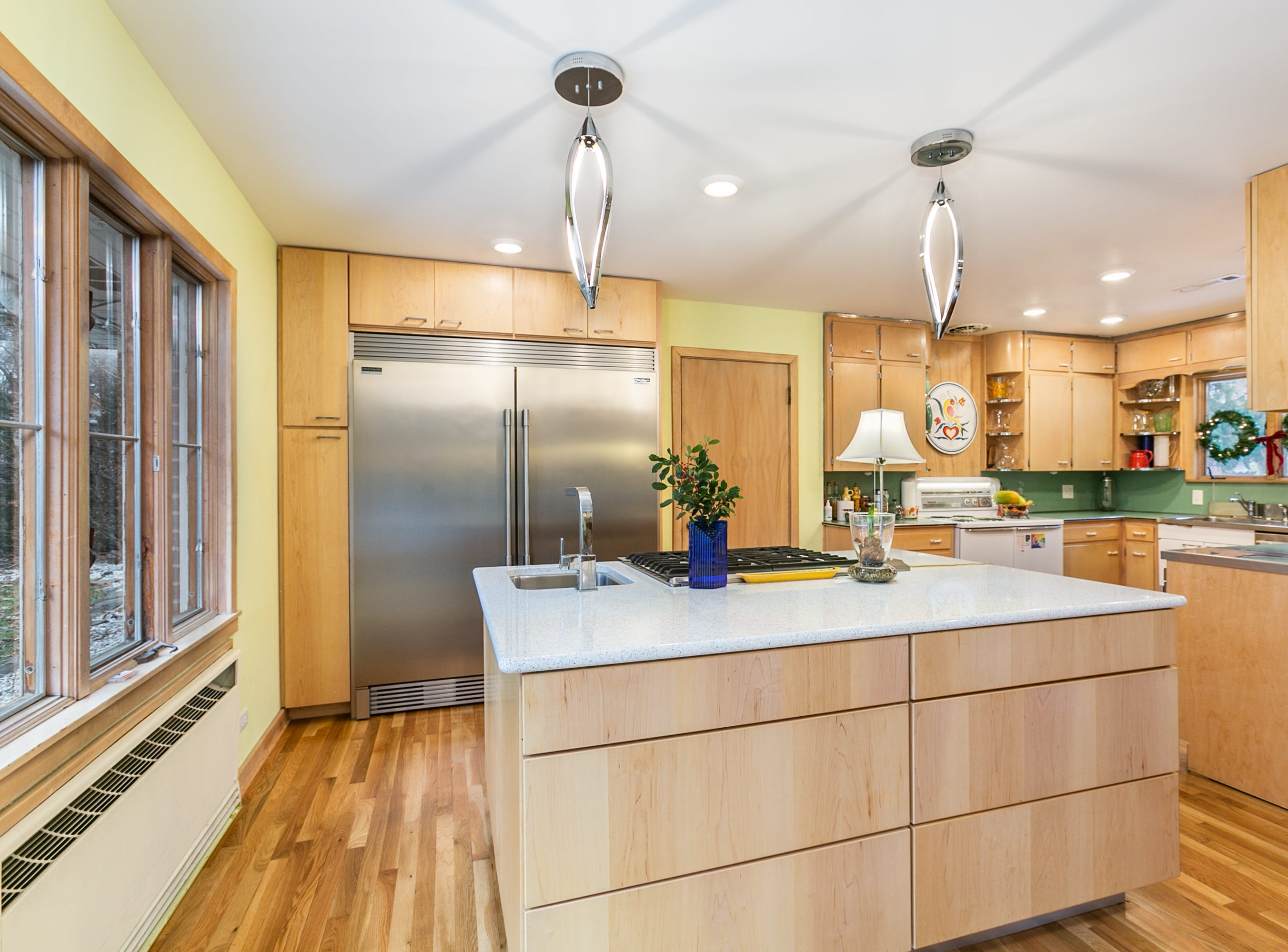 Jeff and Kyaw opted for a professional-grade counter-depth refrigerator and freezer unit. Kyaw has cooked professionally and the two entertain extensively. Jeff says they have neighbors over every Friday for a get-together.