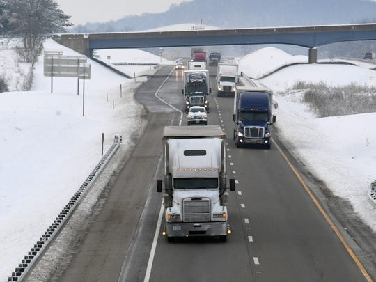 With snow to either side, traffic flows north along Interstate 81 at Staunton following a snowstorm on Monday, Dec. 10, 2018.