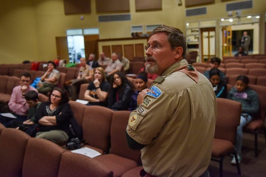 Scoutmaster Lee Hutchins works to recruit female scouts during an open house information session about a new girls troop he is launching, at Old Bridge United Methodist Church in Woodbridge, Virginia.