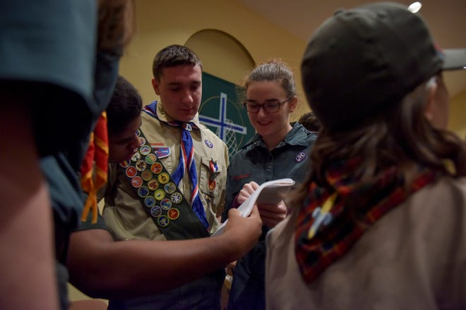 From left, Joe Peters, William Calli and Julie Zylich chat before a Scouts BSA information session. Last month, the Girl Scouts filed a lawsuit against the Boy Scouts for creating unfair competition.