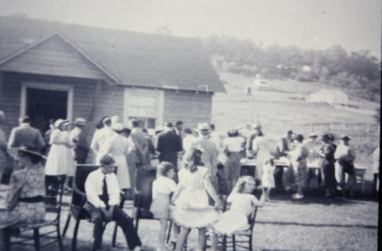 A homecoming  in front of the parish house, probably in the 1950s.