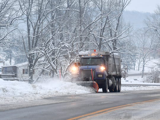 A snowplow clears snow along Mule Academy Road in front of the Augusta Regional Clinic in Fishersville on Monday, Dec. 10, 2018.