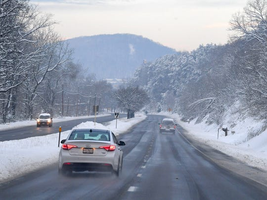 View of U.S. 250 looking towards Staunton following a snowstorm in Fishersville on Monday, Dec. 10, 2018.