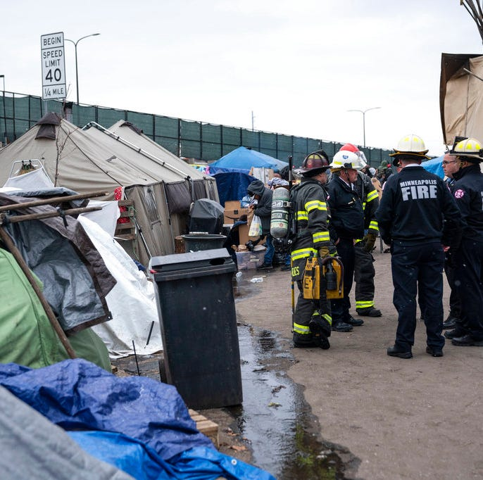 Tensions run high at Minneapolis homeless camp on eve of move to city's tents